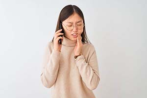 Man in dental chair for emergency dentistry visit