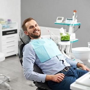 Happy male patient at dental cleaning and checkup