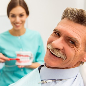 Man in dental chair for preventive dentistry treatment