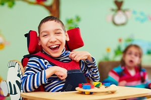 Laughing child in a wheelchair
